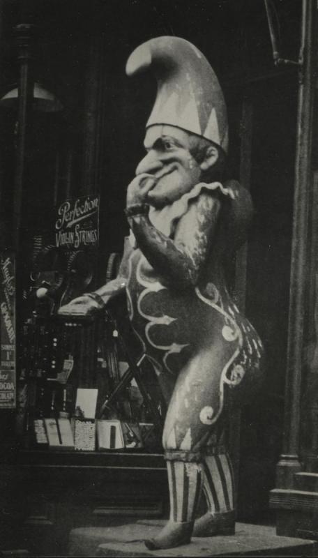 E. O. Hoppé - Wooden Joker Outside Tobacco Shop, New York City, 1926 | Bruce Silverstein Gallery