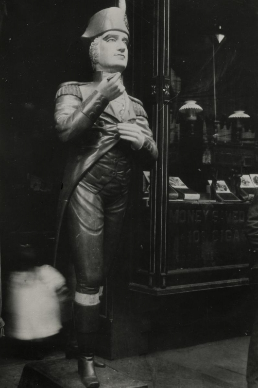 E. O. Hoppé - Wooden Figure Outside Tobacco Shop, New York City, 1926 | Bruce Silverstein Gallery