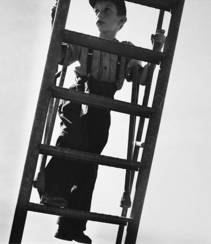 Larry Silver - Boy With Crutches Climbing Ladder, 1950 Gelatin silver print, printed later | Bruce Silverstein Gallery