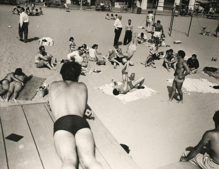 Larry Silver - People Watching Boy Being Balanced, Muscle Beach, CA, 1954 Gelatin silver print, printed 1980 | Bruce Silverstein Gallery