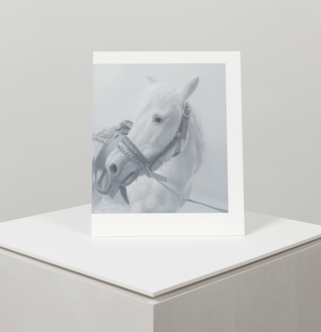 grayscale painting of a horse sitting atop a pedestal