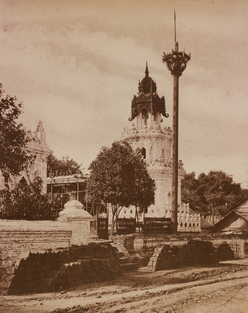 """Captain Linnaeus TRIPE (English, 1822-1902) """"No. 52. Amerapoora. Mosque."""" Burma, 1855 Albumenized salt print from a waxed paper negative 34.3 x 27.3 cm mounted on 58.3 x 45.6 cm paper Signed """"L. Tripe"""" in ink. Photographer's blindstamp and printed label with plate number, title and """"This is in China Street. There are some thousands of Mahomedans and numbers of Mosques in and about Amerapoora. The Architecture of the latter partakes much of the Burmese element."""" on mount."""
