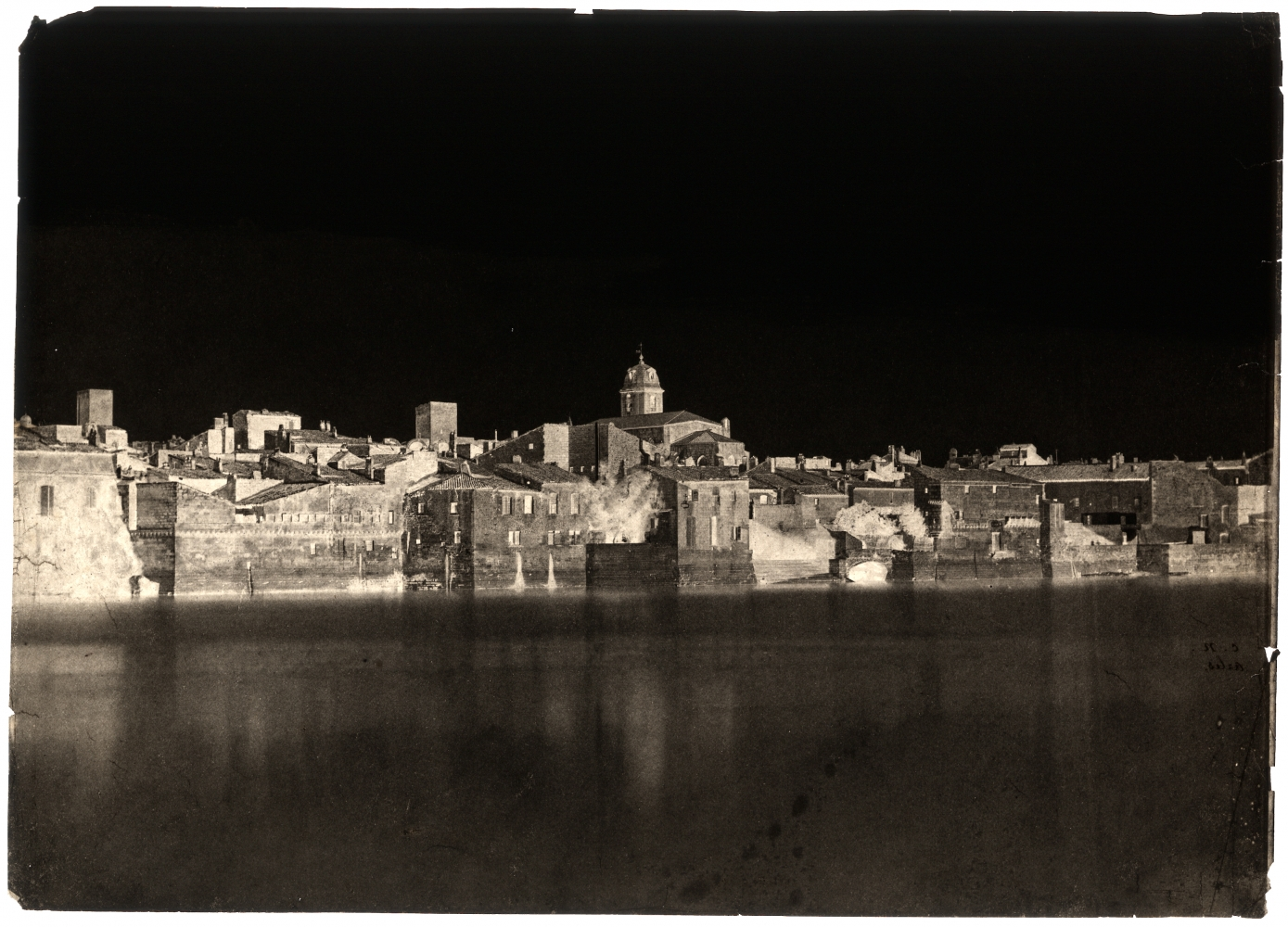 """Charles NÈGRE (French, 1820-1880) View from the banks of the Rhône """"Arles"""", 1852 Waxed paper negative with selectively applied pigment 23.7 x 33.1 cm Initialed """"C.N."""" and titled """"Arles."""" in black ink on verso"""