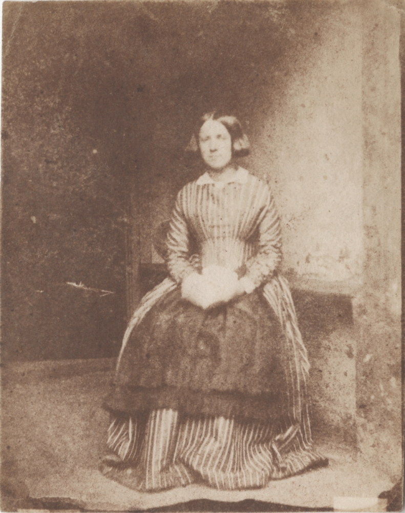 Rev. Calvert Richard JONES (Welsh, 1802-1877) Portrait of a lady, possibly a domestic servant, in a striped dress, late 1840s Salt print from a calotype negative 11.1 x 8.8 cm