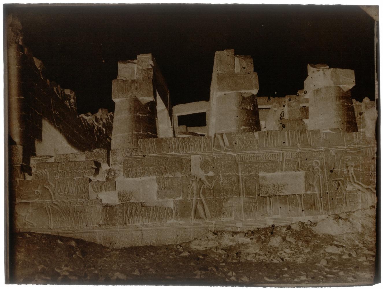 "John Beasley GREENE (American, born in France, 1832-1856) Great Hypostyle Hall, outer face, north wall, Karnak, 1854-1855 Waxed paper negative 24.0 x 31.8 cm  Watermark ""J Whatman"""