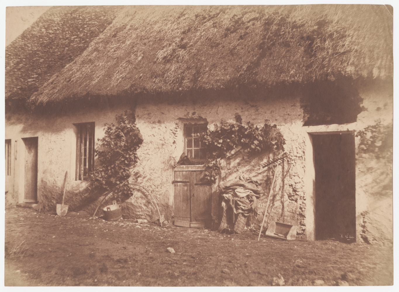 """Henri LE SECQ (French, 1818-1882) Façade d'une ferme, 1851 Salt print from a waxed paper negative 24.7 x 34.1 cm Signed in the negative. Inscribed """"X"""" lightly in pencil on verso."""