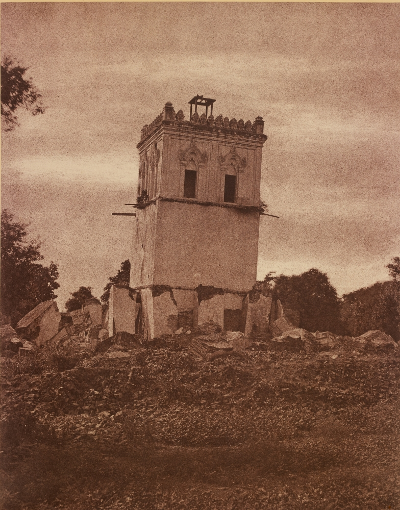 """Captain Linnaeus TRIPE (English, 1822-1902) """"No. 37. Ava. Tower of the Palace."""" Burma, 1855 Albumenized salt print from a waxed paper negative 33.7 x 26.6 cm mounted on 58.4 x 45.7 cm paper Signed """"L. Tripe"""" in ink. Photographer's blindstamp and printed label with plate number, title and """"This is the only co-herent remains of the palace. The earthquake of 1839 covered the ground with the rest of it and tilted this considerably."""" on mount."""