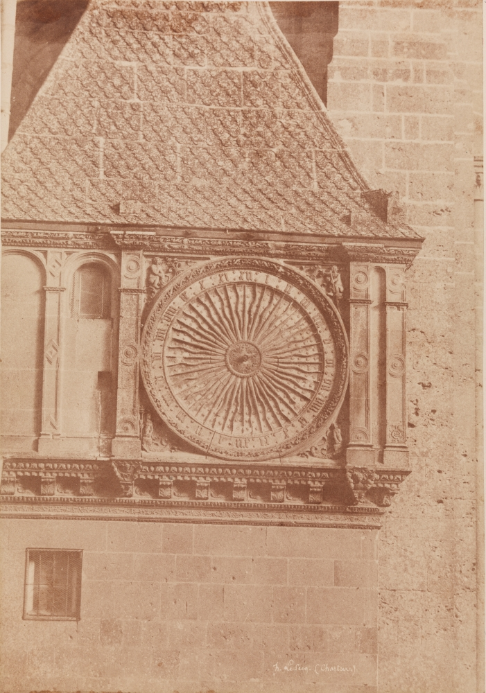 """Henri LE SECQ (French, 1818-1882) Astronomical clock, Chartres Cathedral, 1852 Coated salt print from a paper negative 35.0 x 24.4 cm mounted on 59.5 x 46.2 cm card Signed and titled """"h. Le Secq. (Chartres.)"""" in the negative"""