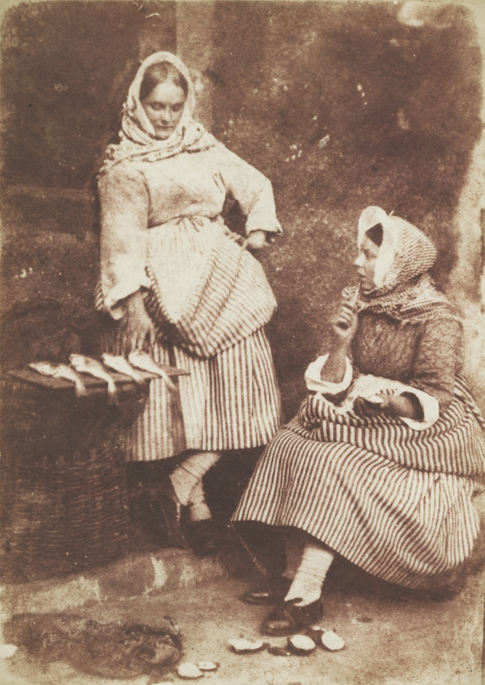 """David Octavius HILL & Robert ADAMSON (Scottish, 1802-1870 & 1821-1848) Jeanie Wilson and Annie Linton, Newhaven, """"They were twa bonnie lasses"""", circa 1845 Salt print from a calotype negative 19.0 x 13.6 cm mounted on 37.4 x 26.2 cm grey paper """"58"""" noted in pencil on mount verso"""