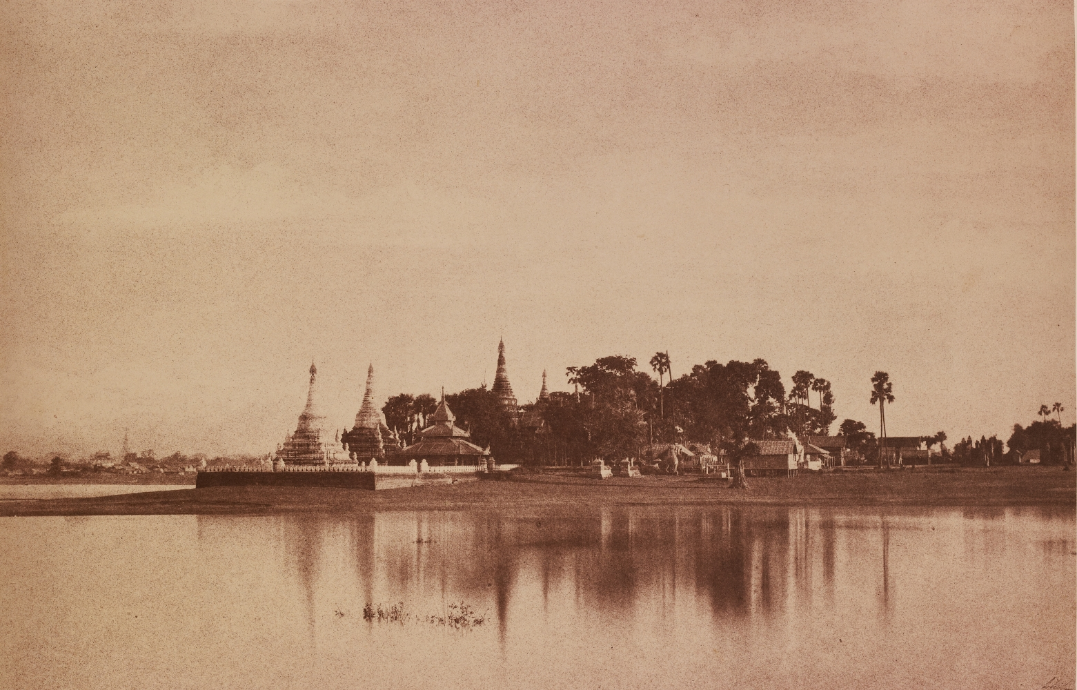 """Captain Linnaeus TRIPE (English, 1822-1902) """"No. 56. Amerapoora. View on the Lake."""", September-October 1855 Albumenized salt print from a waxed paper negative 22.4 x 34.8 cm mounted on 45.6 x 58.3 cm paper Signed """"L. Tripe"""" in ink. Photographer's blindstamp and printed label with plate number, title and """"Taken from the causeway crossing the Toung-deman lake at its Eastern extremity. A glimpse of the city is caught on the left."""" on mount."""