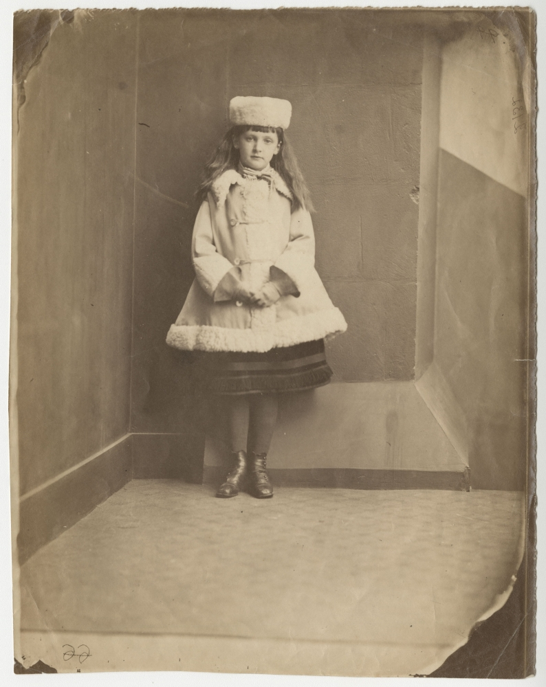 """Lewis CARROLL (Charles Lutwidge Dodgson) (English, 1832-1898) Xie (Alexandra) Kitchin as a """"Dane"""", 1873 Albumen print from a collodion negative 21.0 x 16.5 cm on 21.0 x 16.7 cm paper, untrimmed and unmounted """"2132"""" inscribed in violet ink by Carroll. """"Xie Kitchin"""" inscribed in ink and various numeric notations inscribed in pencil, likely not in Carroll's hand, on verso."""