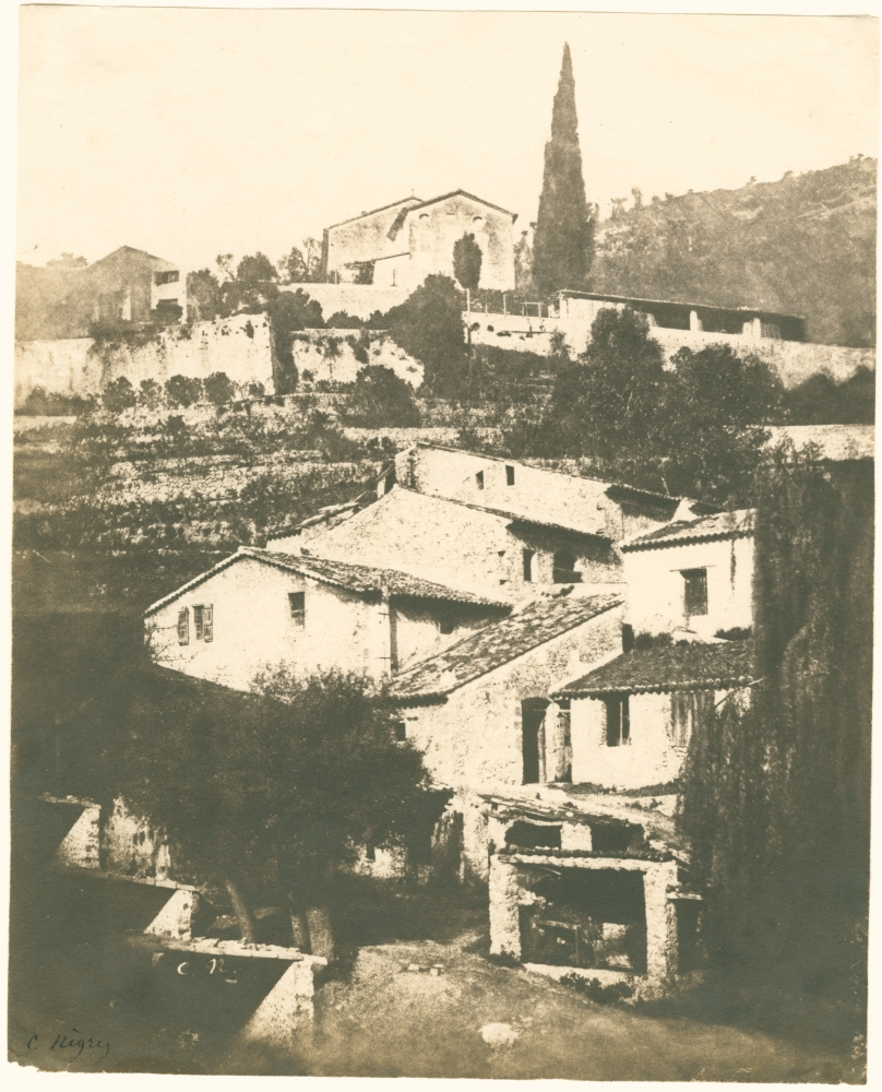 """Charles NÈGRE (French, 1820-1880) Mills with cypress, Grasse*, 1852 Salt print from a waxed paper negative 19.2 x 15.6 cm Initialled in the negative and signed """"C. Negre"""" in ink. Inscribed """"E-24"""" and """"No. 89"""" in pencil on verso."""
