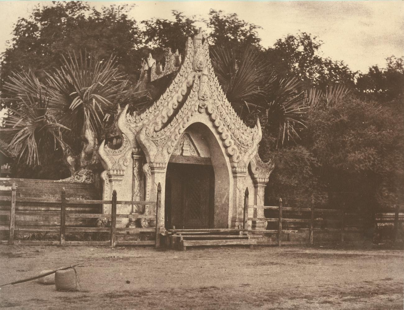 """Captain Linnaeus TRIPE (English, 1822-1902) """"No. 60. Amerapoora. Gateway of Maja Bounghian Kyoung."""", 1855 Albumenized salt print from a waxed paper negative 28.6 x 34.8 cm mounted on 45.6 x 58.3 cm paper Printed label with plate number, title and """"A solidly built wall usually surrounds Kyoungs; in the centre of each side of which is a gateway similar to the above."""" on mount"""