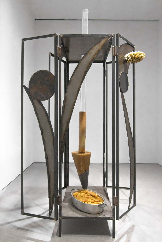 sculpture made of a large metal frame with wax elements attached