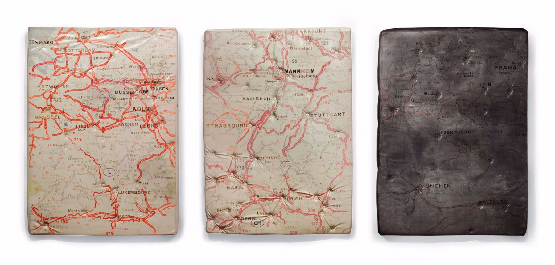 three paintings of maps on mattresses