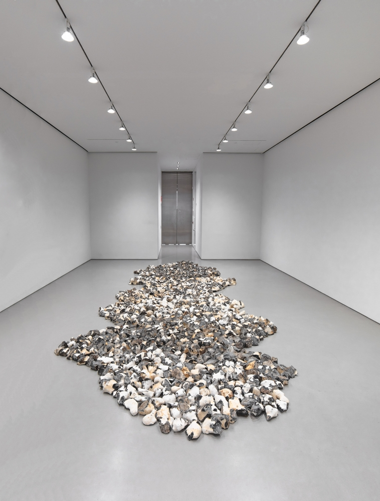 floor sculpture made of pieces of flint installed in a gallery