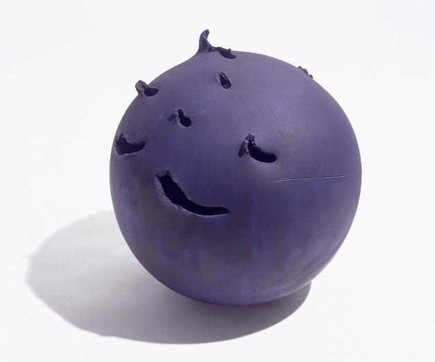spherical purple ceramic sculpture with irregular perforations