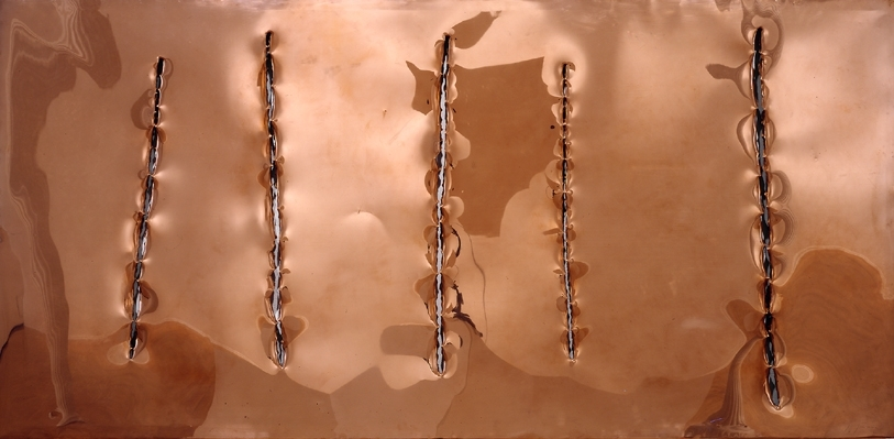 copper sheet with five vertical slashes