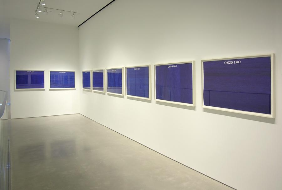 installation view of 8 framed blue works on paper