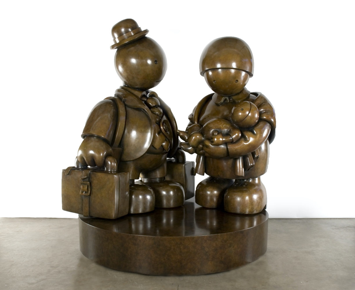 Bronze sculpture of an immigrant family with baby by Tom Otterness.