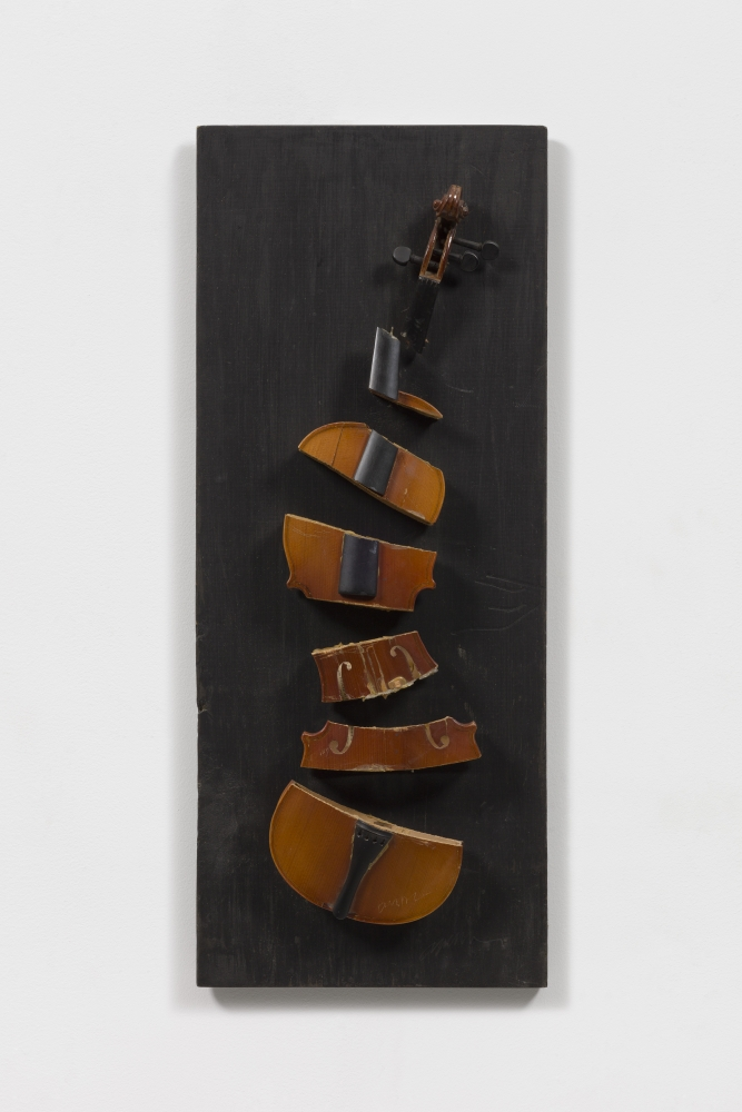 Violin sliced in seven parts on a dark wood panel