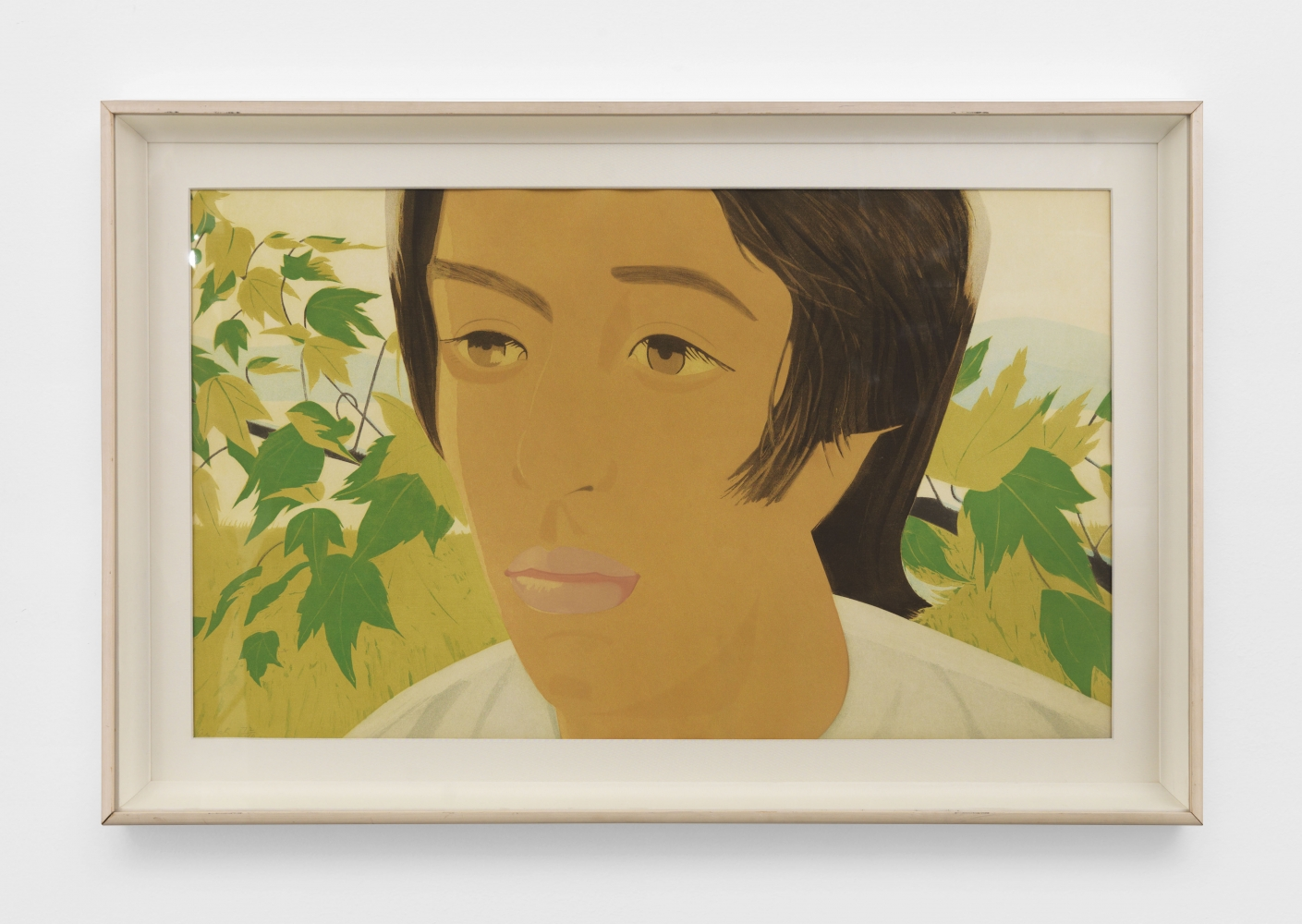 Framed color aquatint by Alex Katz featuring a boy with brown hair and wearing a white shirt against a green foliage background