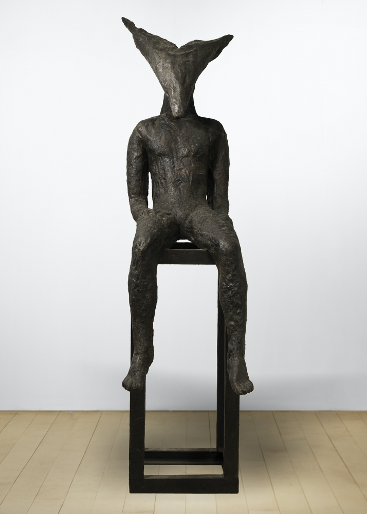 Bronze sculpture by Magdalena Abakanowicz of a seated figure with an angular head on a pedestal