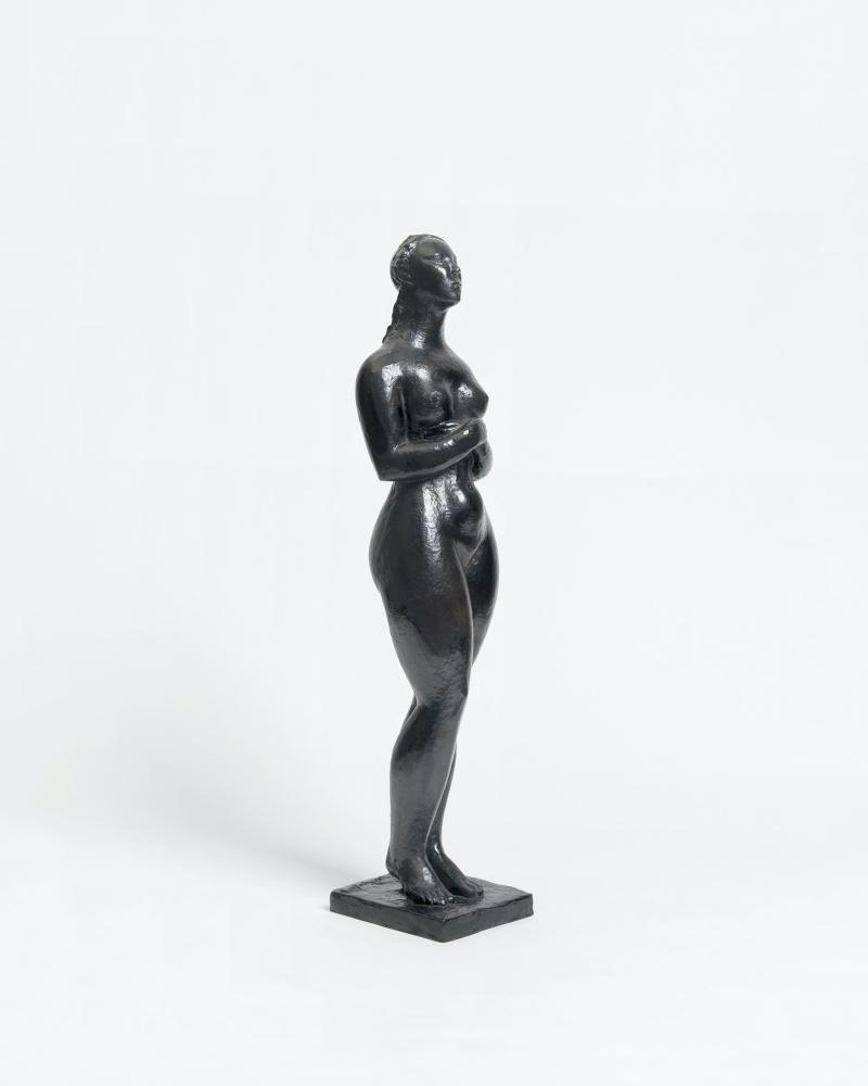 Bronze sculpture depicting a pregnant woman.