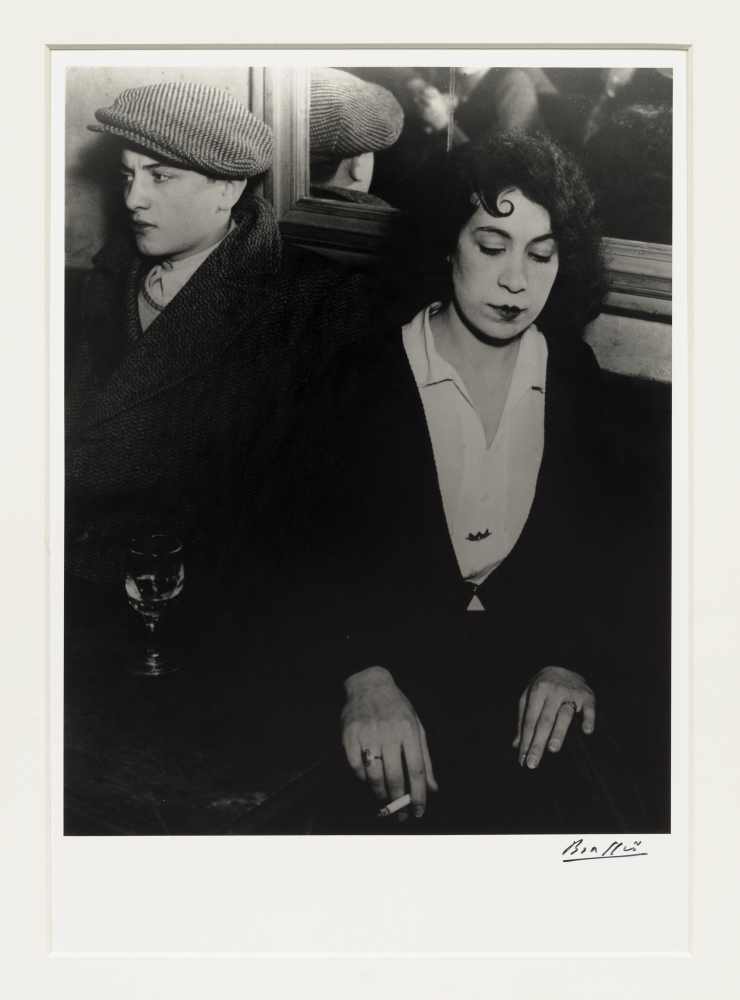 Black and white photographic portrait of couple in a lover's quarrel.