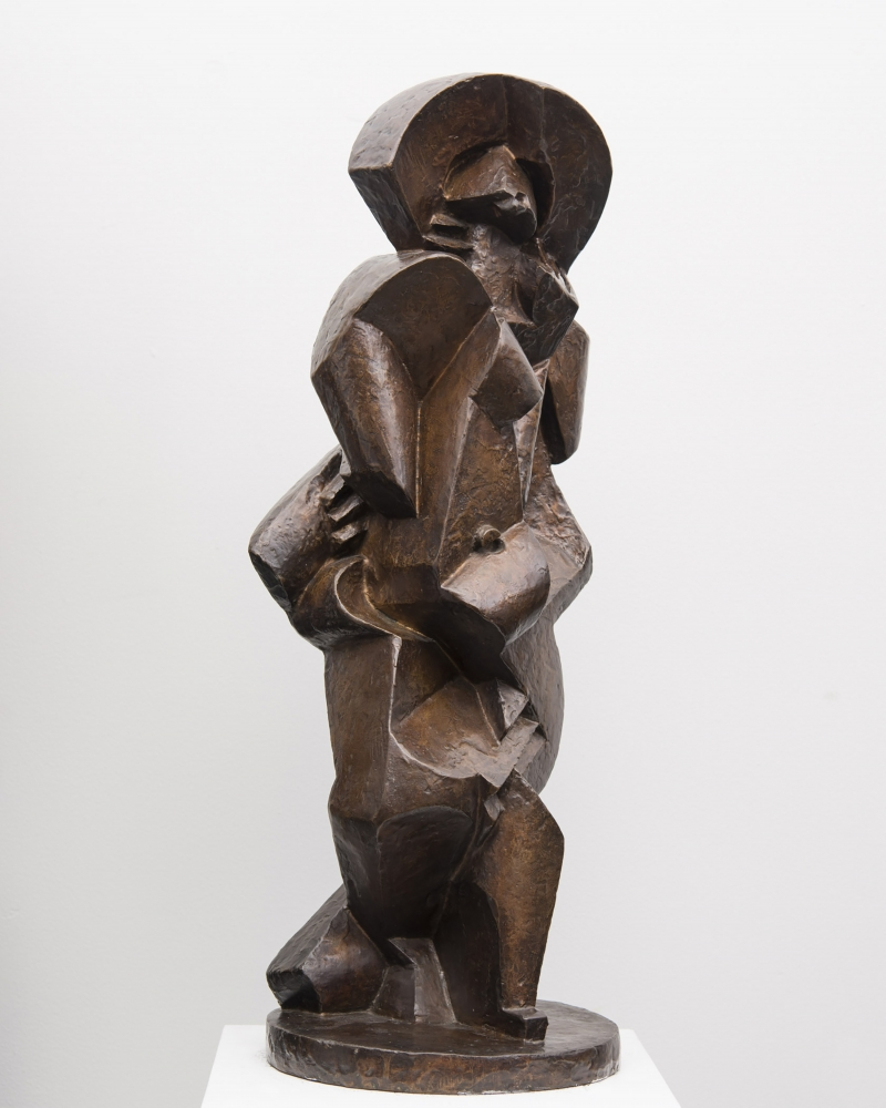 Bronze statue depicting abstract bather.