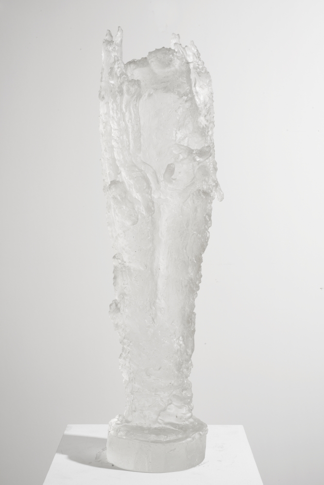 Cylindrical cast glass sculpture with circular base by Michele Oka Doner.