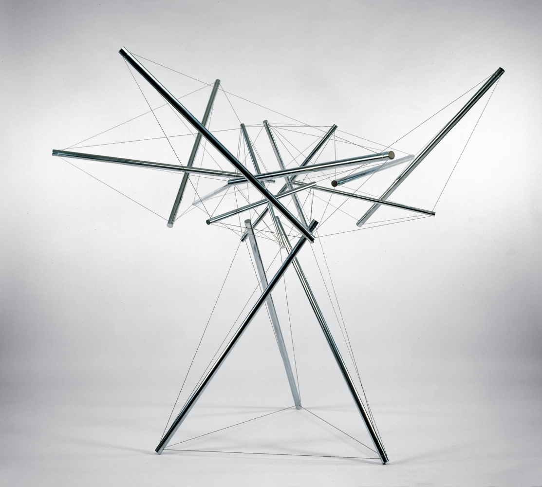 Upright web of stainless steel cylinders held together with wire resembling a tree.