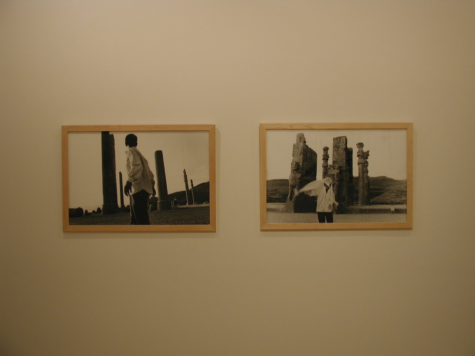 Two framed black and white photographs of a man standing in front of stone columns in the exhibition Sadegh Tirafkan at Lehmann Maupin in New York in 2004