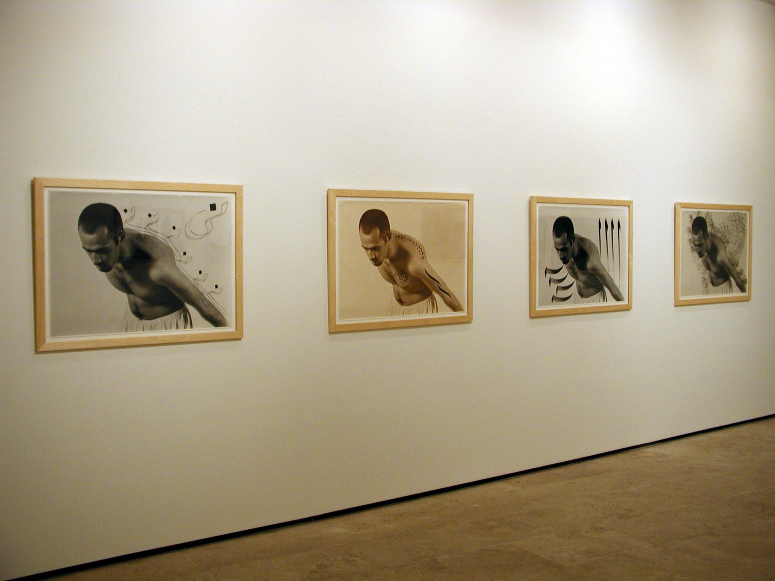 Four framed black and white and sepia tone photographs of a man in the exhibition Sadegh Tirafkan at Lehmann Maupin in New York in 2004