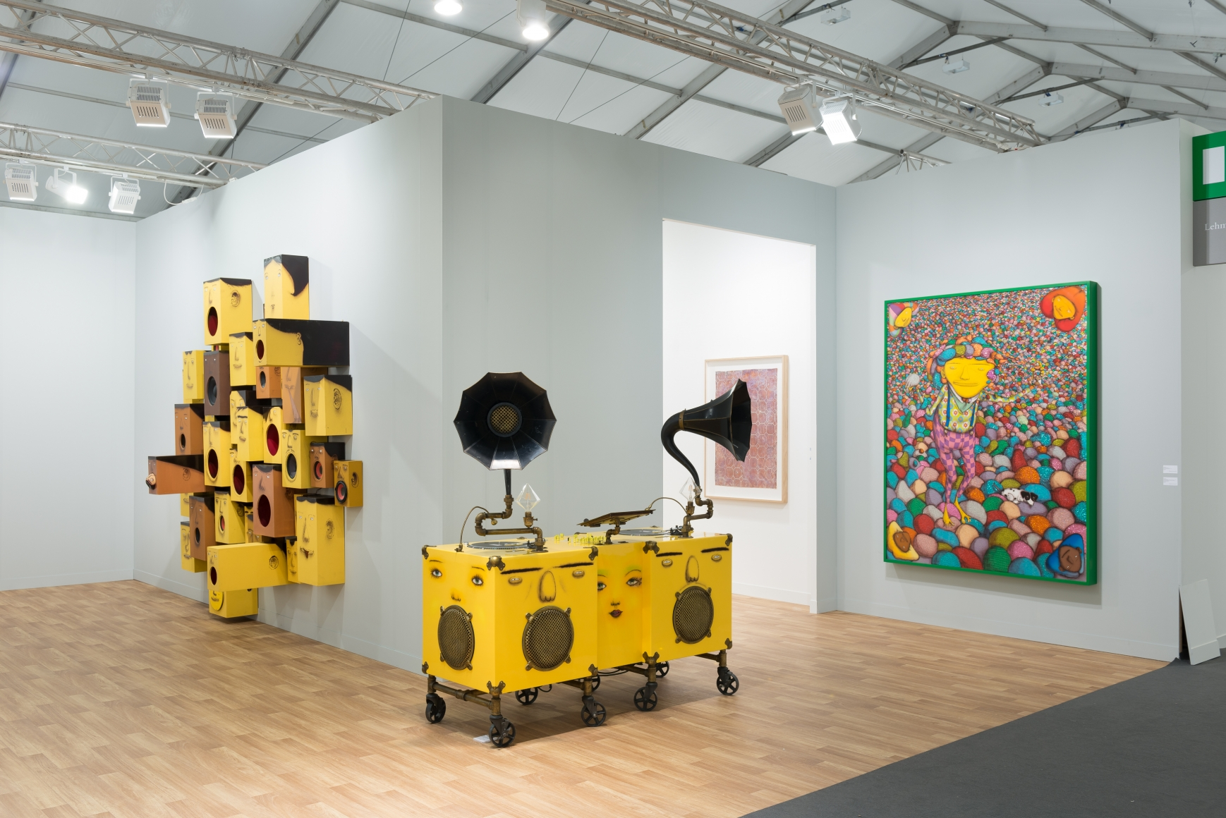 View of Lehmann Maupin's art fair booth at Frieze London 2018 featuring OSGEMEOS, perspective 4