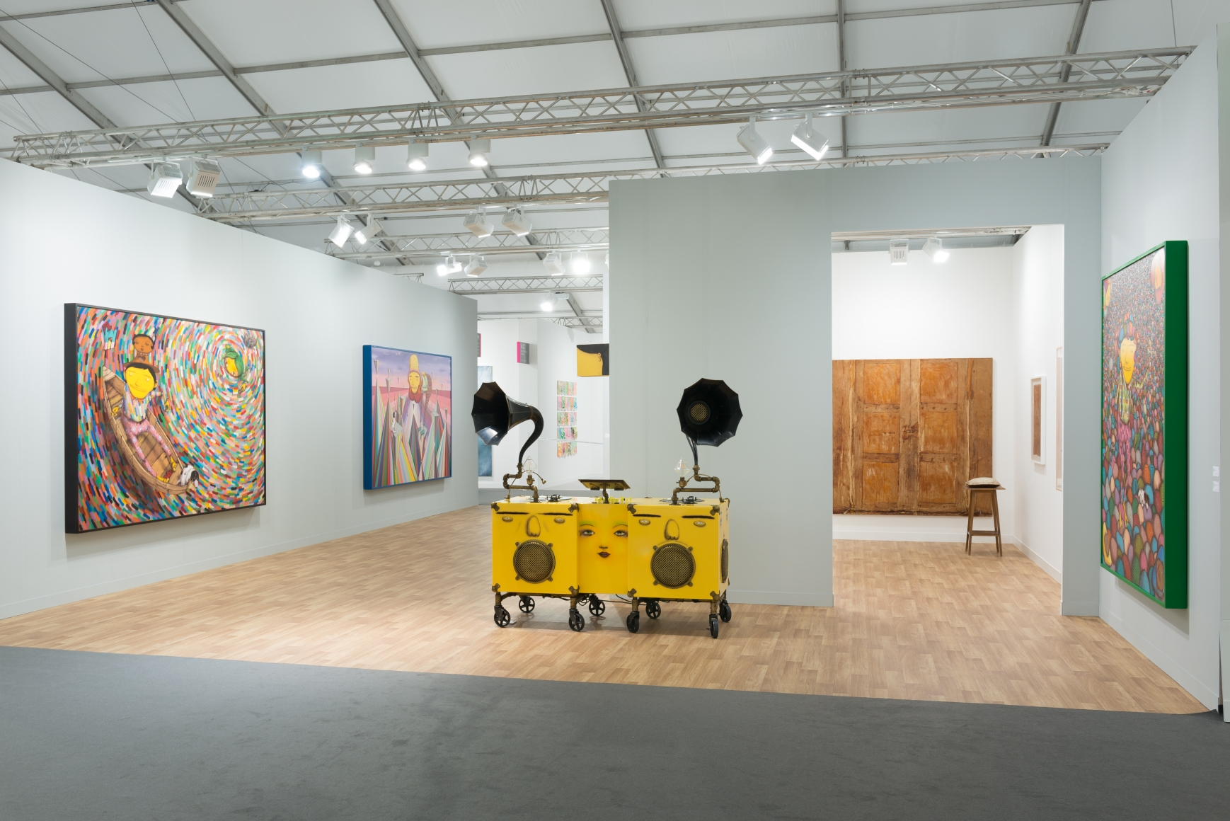 View of Lehmann Maupin's art fair booth at Frieze London 2018 featuring OSGEMEOS, perspective 3