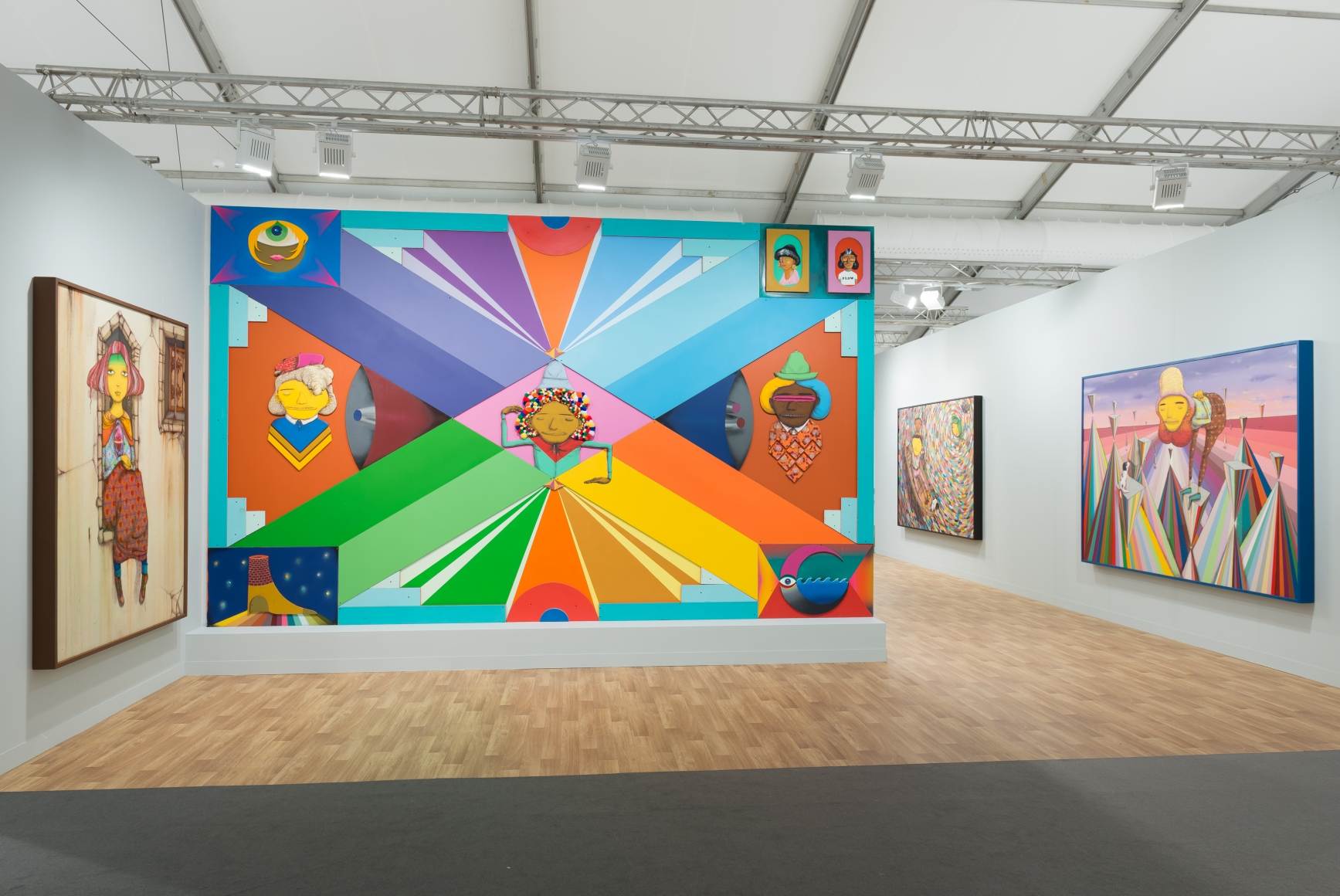 View of Lehmann Maupin's art fair booth at Frieze London 2018 featuring OSGEMEOS, perspective 2