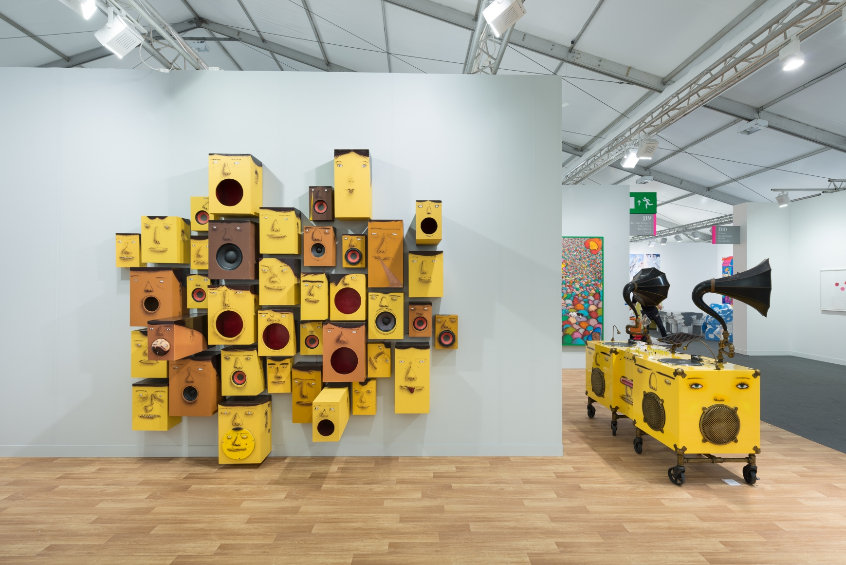 View of Lehmann Maupin's art fair booth at Frieze London 2018 featuring OSGEMEOS, perspective 5