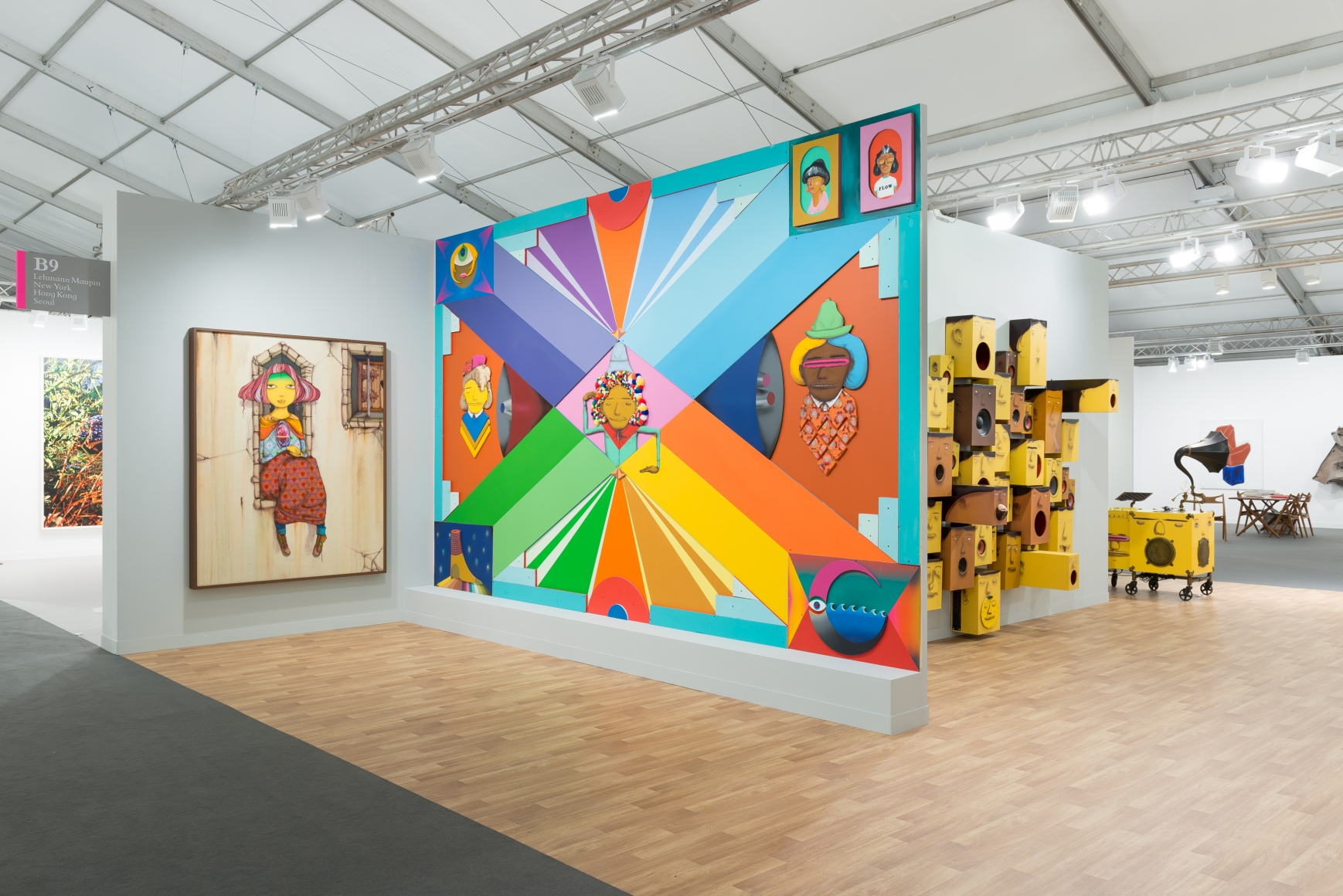 View of Lehmann Maupin's art fair booth at Frieze London 2018 featuring OSGEMEOS, perspective 1