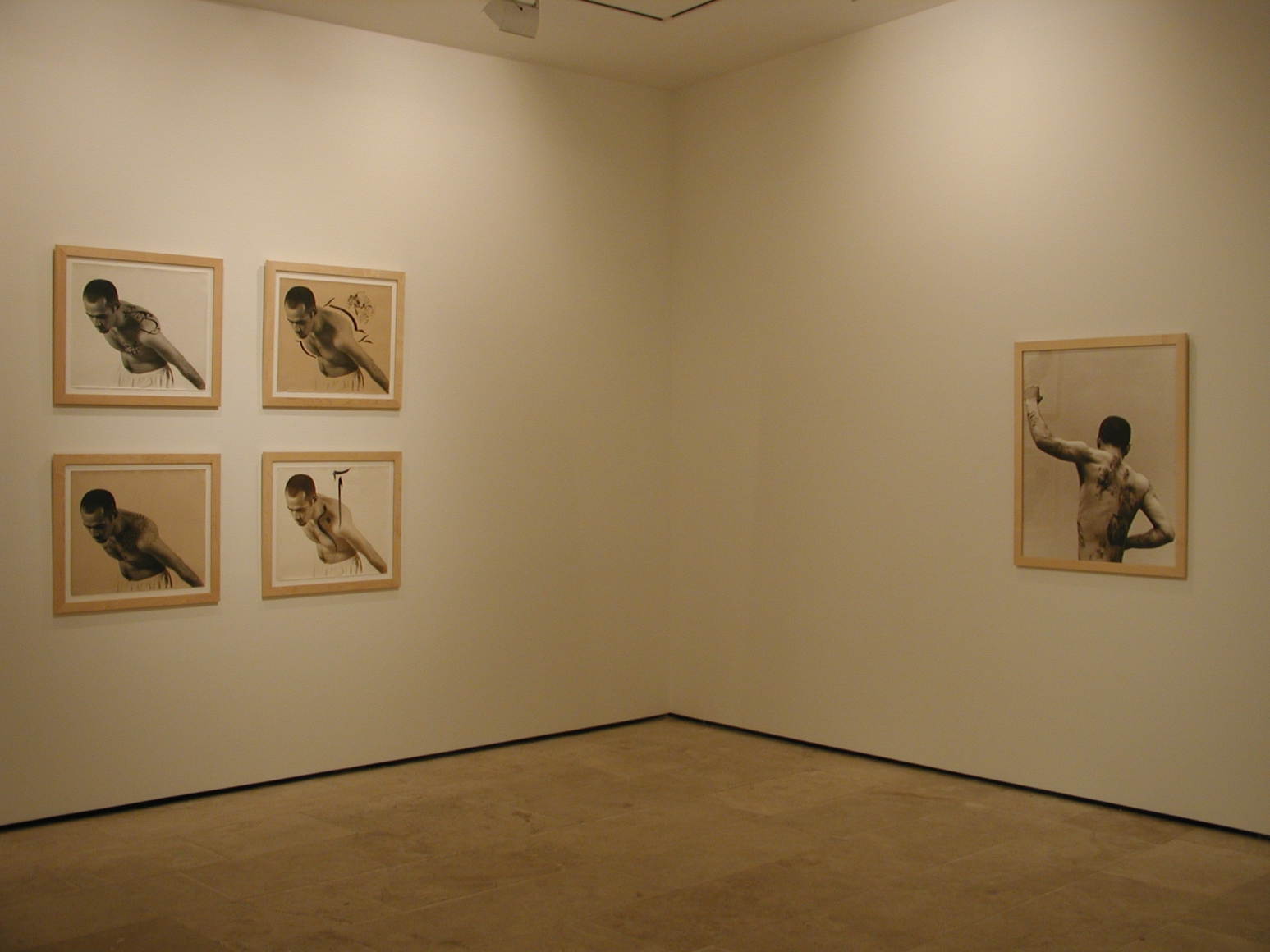 Five framed photographs in the exhibition Sadegh Tirafkan at Lehmann Maupin in New York in 2004