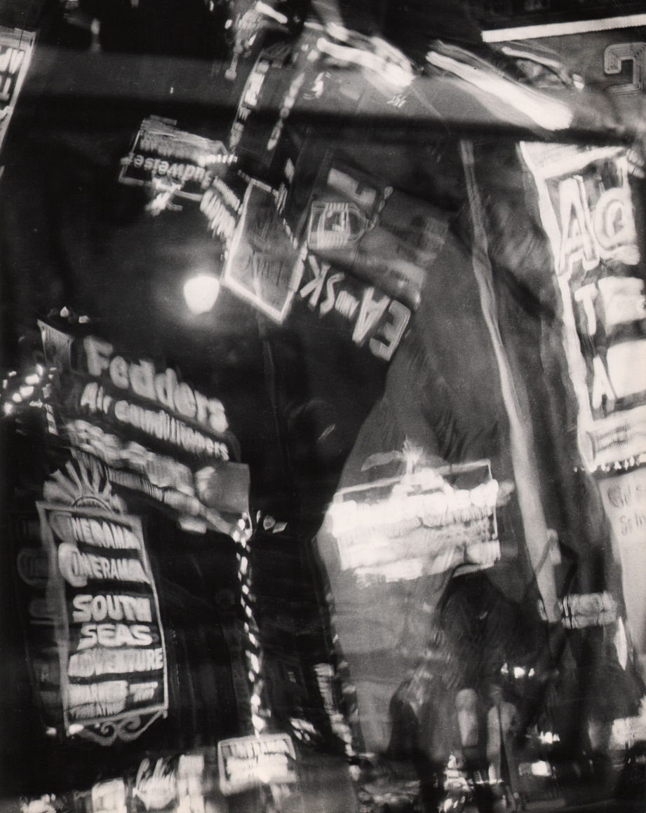 25. David Attie, Times Square, c. 1958. Multiple exposures of neon signs and marquees at night.