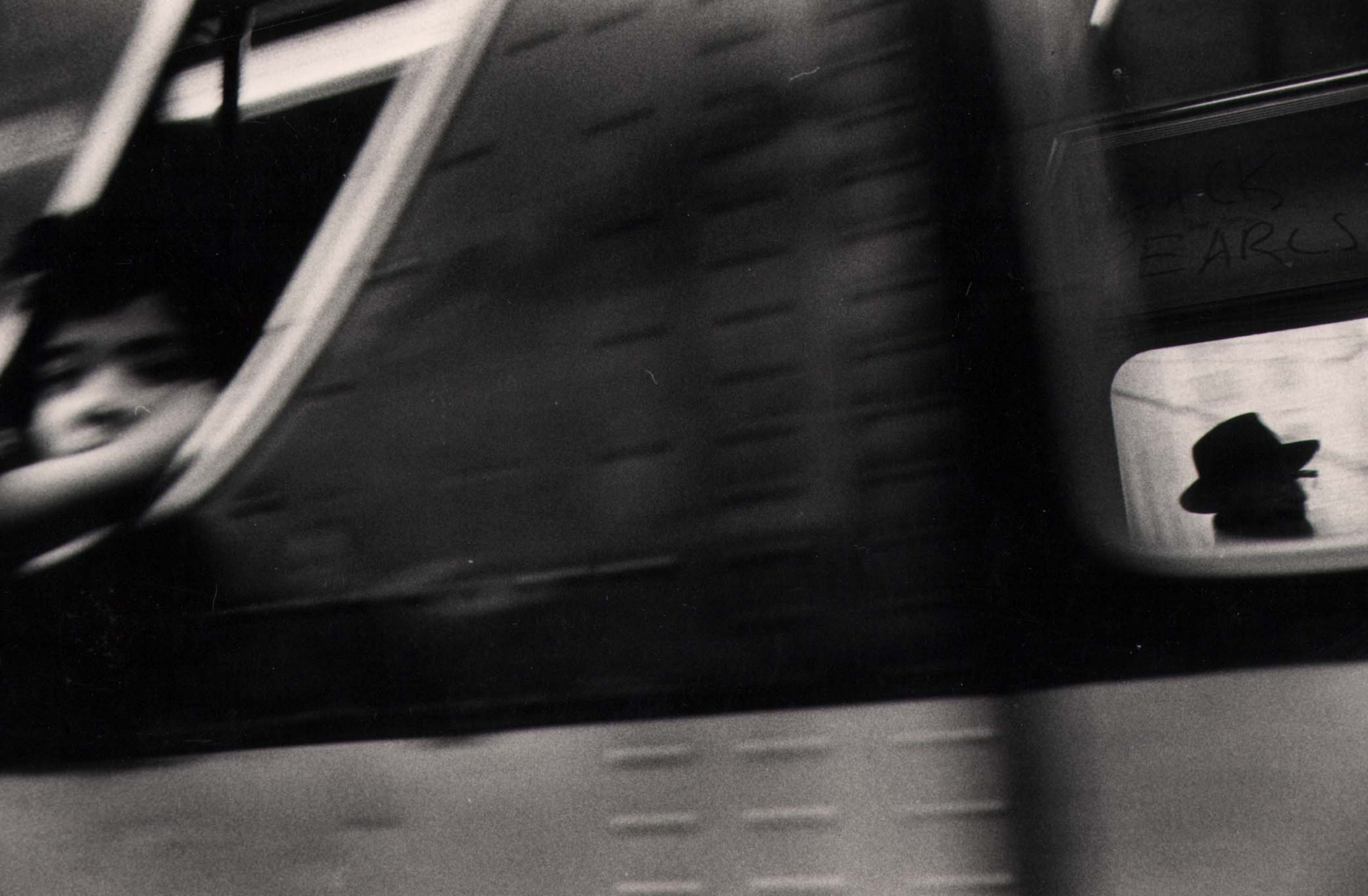 15. Anthony Barboza, NYC, 1970s. Motion-blurred close up of a subway window; two figures can be perceived on the left and right of the frame.