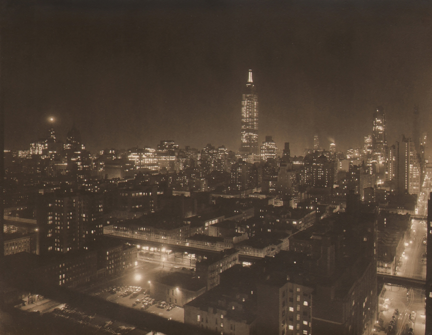 Paul J. Woolf, Empire State Building, c. 1933. Night time cityscape with Empire State Building in center of frame in background.