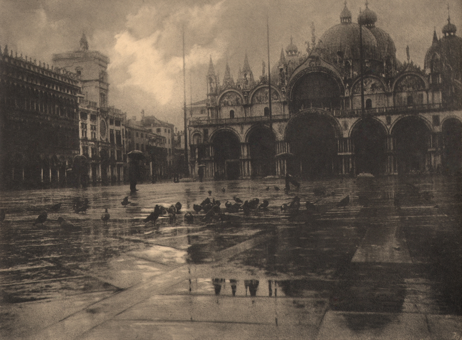 32. Léonard Misonne, Pluie Venise, 1936. Italian square with wet pavement and pigeons, ornate buildings in the background. Sepia-toned print.