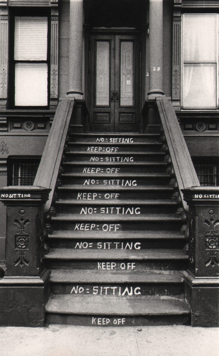"""26. Beuford Smith, NO and KEEP OFF, Harlem, 1982. A building stoop with """"No sitting"""" and """"Keep off"""" written on alternating steps."""