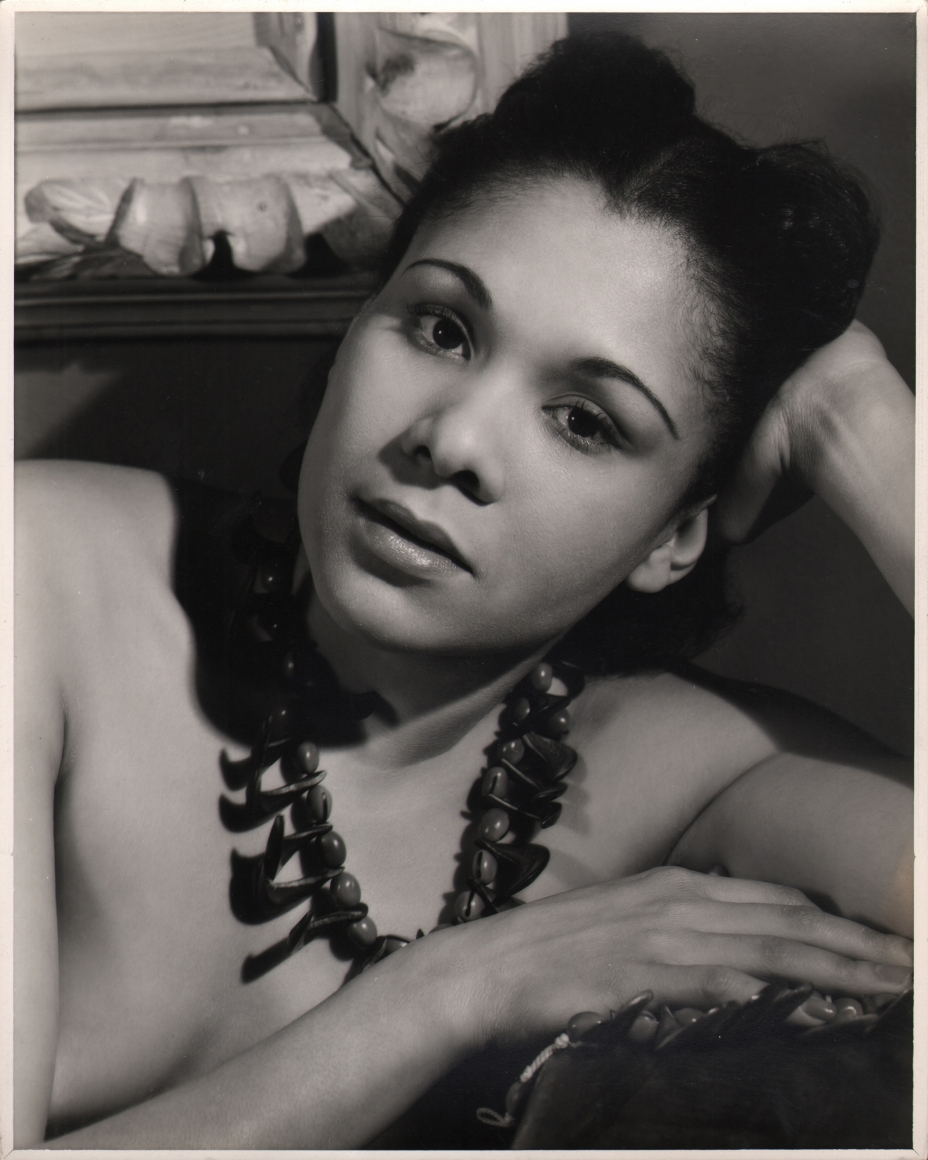 Alfredo Valente, Katherine Dunham, c. 1940. Subject is photographed leaning on one arm, looking into the camera.