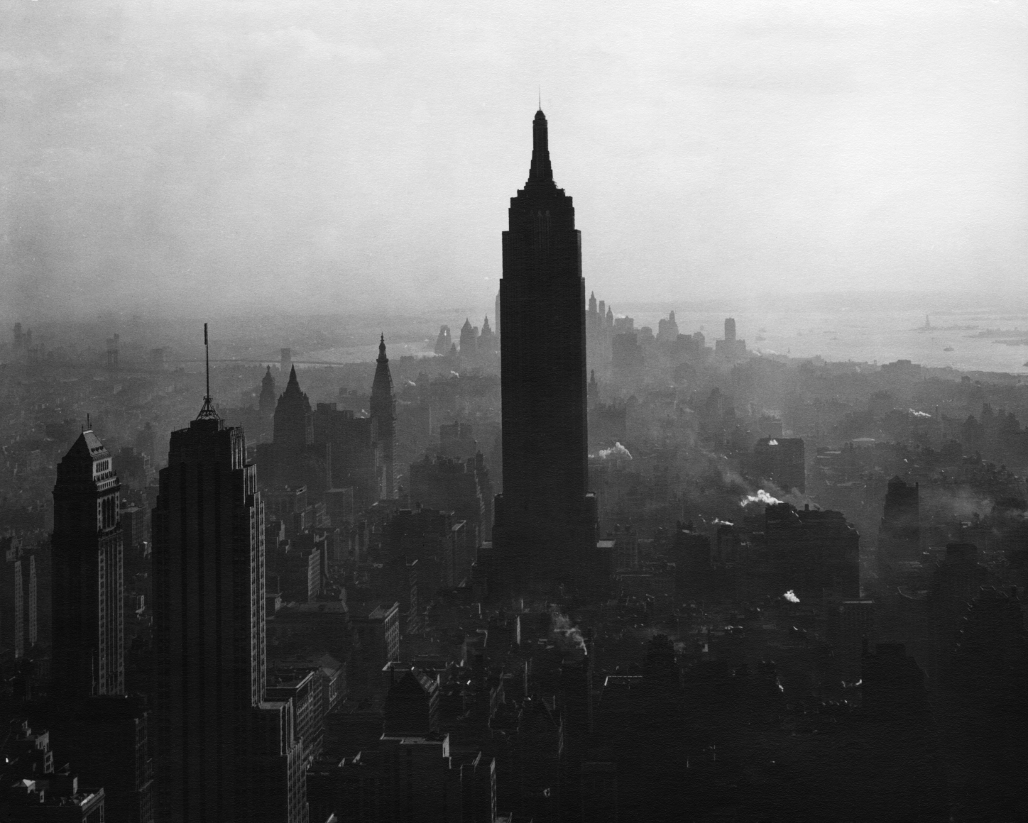 38. Todd Webb, View South from the top of the RCA Building showing the Empire State Building, 1947. Elevated view of the silhouetted Empire State and surrounding buildings amidst light fog.