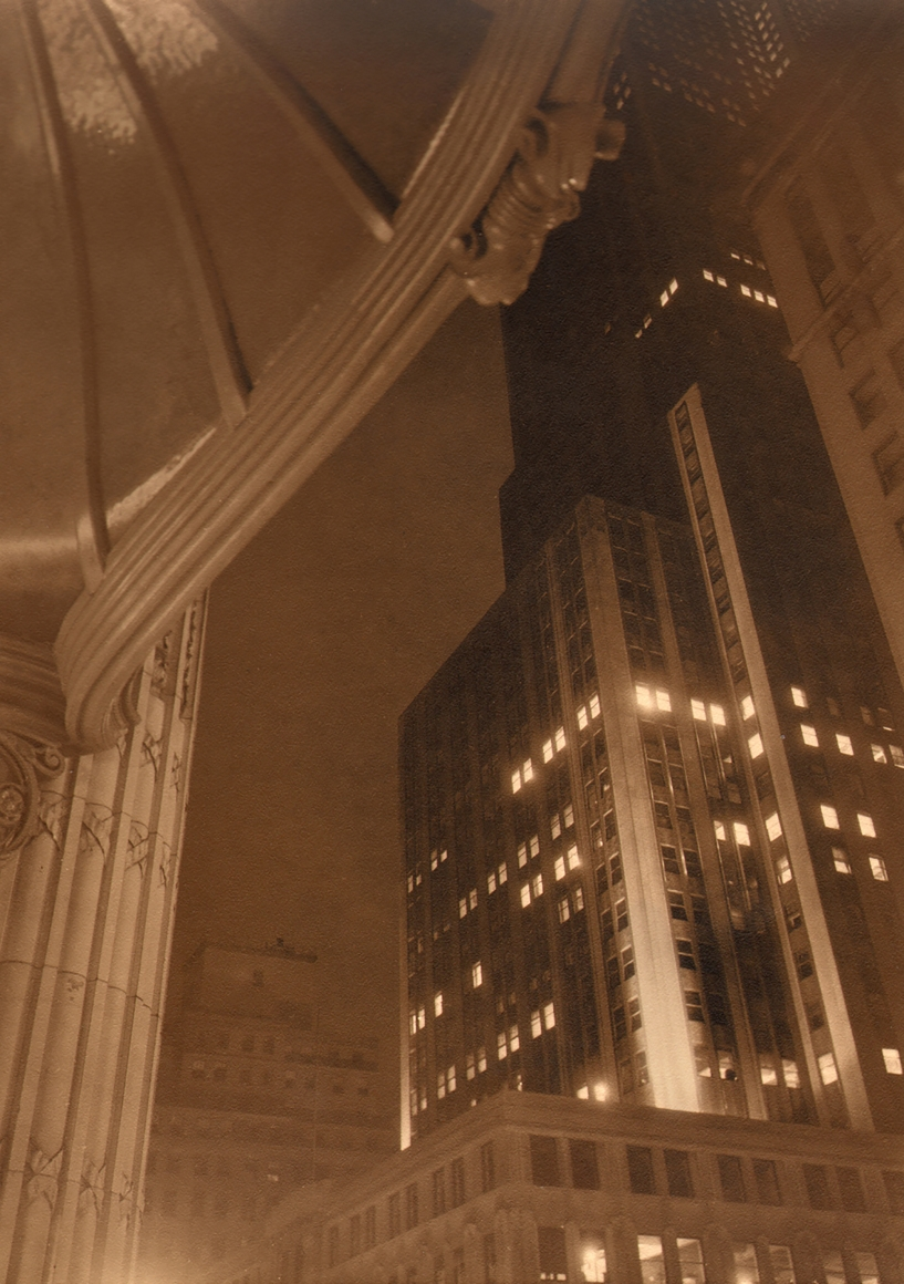 Paul J. Woolf, Altman's Canopy Against the Empire State Building, c. 1937. Looking up from beneath a domed structure supported by columns (left) with a view of the Empire State Building on the right of the frame.