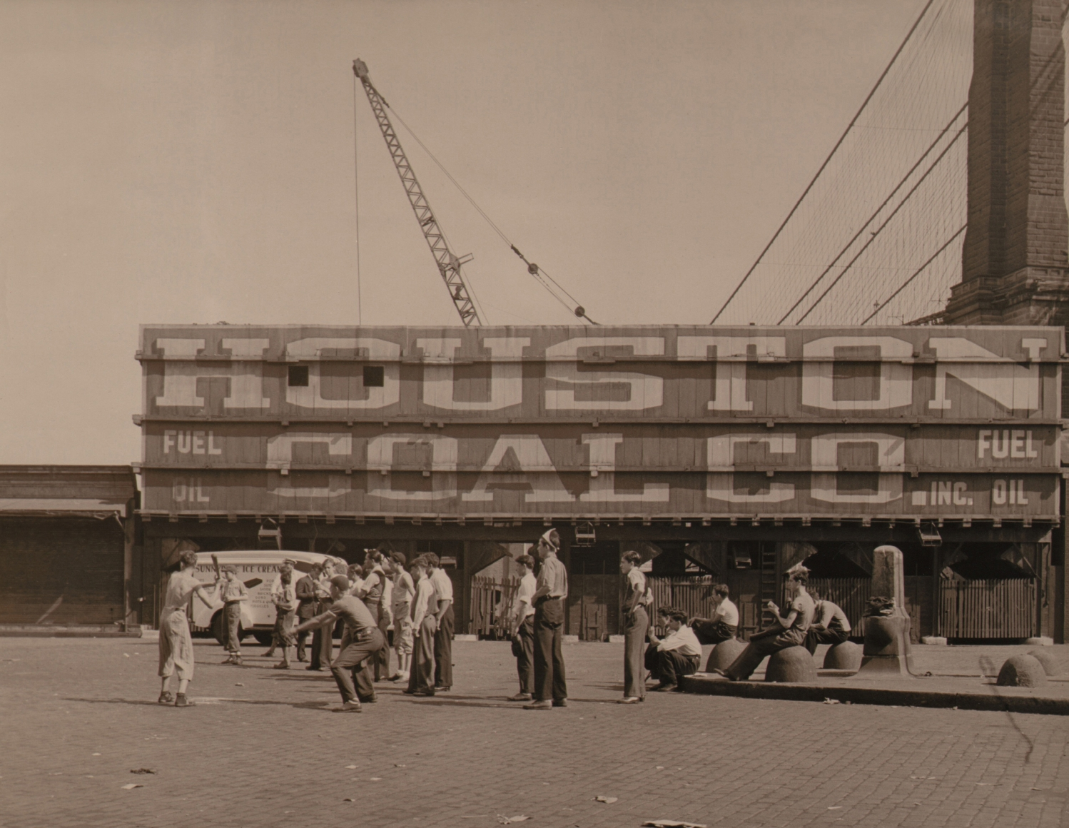"""Paul J. Woolf, Baseball Game, c. 1933. Men play baseball in front of a structure marked """"Houston Coal Co."""""""