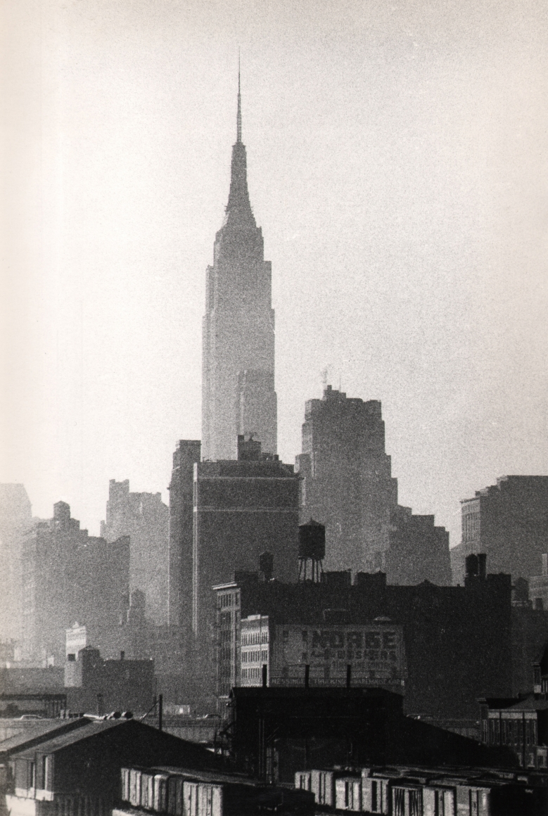 36. Marvin Koner, Empire State Building, c. 1955. Grainy vertical composition with the Empire State at the center climbing above surrounding builidings.